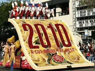 """A big float in a parade that has the words, """"2010 a cut above the rest"""" written on it."""